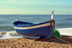 Fisherman boat on the beach at sunrise time stock photos
