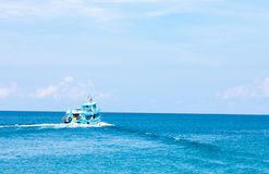 Fisherman boat. And the blue sea Stock Photography