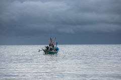 Fisherman Boat. On a cloudy morning Royalty Free Stock Image