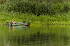 Fisherman on a boat Royalty Free Stock Photography