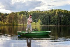 A fisherman in a boat Stock Photos