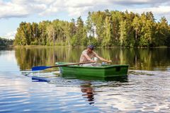 A fisherman in a boat Royalty Free Stock Photos