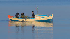 Fisherman in a boat. Fishing on the Black Sea Royalty Free Stock Photo