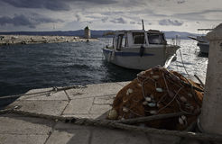 Fisherman boat and fishing net Stock Photos