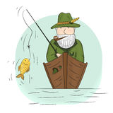 Fisherman in a boat with a fishing rod. Stock Photos
