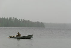 Fisherman boat fog rain Royalty Free Stock Photos