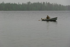 Fisherman boat fog rain Royalty Free Stock Photo