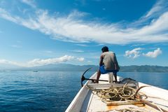 Fisherman on a boat Royalty Free Stock Photo