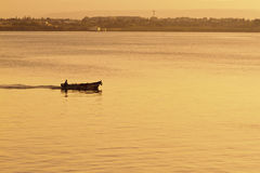 Fisherman and boat in harbor Stock Photography