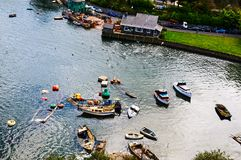 Fisherman boat harbour village. In Wales, UK, england cloudy sky and green hills Royalty Free Stock Image