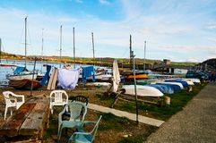 Fisherman boat harbour village. In Wales, UK, england cloudy sky and green hills Stock Photography