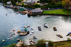 Fisherman boat harbour village. In Wales, UK, england cloudy sky and green hills Royalty Free Stock Photo
