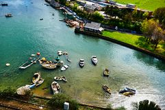 Fisherman boat harbour village. In Wales, UK, england cloudy sky and green hills Royalty Free Stock Photos