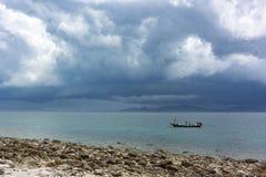 Fisherman boat hide from big rain storm Stock Photos