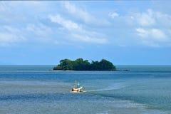Fisherman boat and island Stock Image