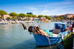 Fisherman boat in Italy. Traditional fisherman boat in the city centre of Grado, Italy royalty free stock photo