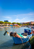 Fisherman boat in Italy. Traditional fisherman boat in the city centre of Grado, Italy Stock Image