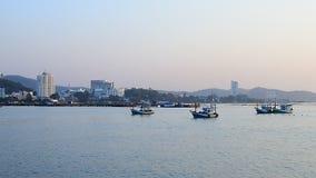 Fisherman boat beside the jetty stock footage