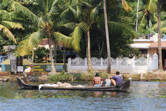 Fisherman on boat in Kerala. Fisherman rowing boat in Kerala, India Stock Photography