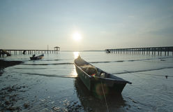 Fisherman boat left alone before sunset Royalty Free Stock Photos