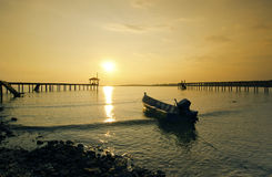 Fisherman boat left alone before sunset Stock Images