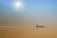 Fisherman in boat Royalty Free Stock Images