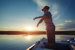 Fisherman on the boat royalty free stock image