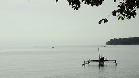 Fisherman with boat in morning at bali, indonesia stock footage