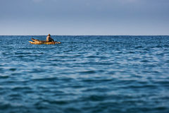 Fisherman in boat on ocean with big waves in Zanzibar Stock Images