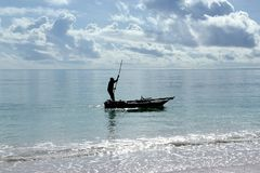 Fisherman on boat in ocean near to Zanzibar royalty free stock images
