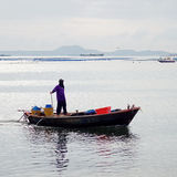 Fisherman in boat on 17 October 2013 in Chonburi, Thailand Stock Photo