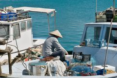 Fisherman on the boat Stock Photography