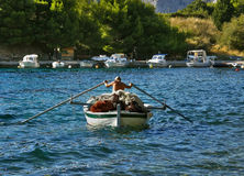 Fisherman with a boat and a paddle royalty free stock photos