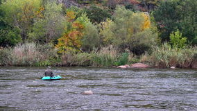 Fisherman in boat on river stock video footage