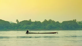 Fisherman on the boat. In the river and natural Royalty Free Stock Photography