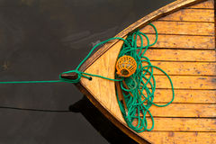 Fisherman boat with ropes and float. Norway. Wooden boat made fast to the pier Stock Photography