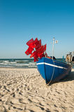 Fisherman boat on a sandy shore Stock Images