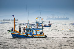Fisherman with boat in sea Stock Photo