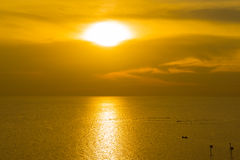 Fisherman on boat at sea with sunset Royalty Free Stock Photo