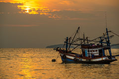 Fisherman boat on sea during sunset. Royalty Free Stock Image