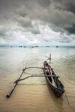 Fisherman boat at the seashore Royalty Free Stock Photos