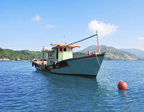 Fisherman boat at seychelles at his moorings Royalty Free Stock Image