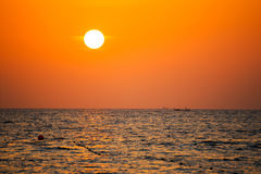 Fisherman boat silhouette at sunset Royalty Free Stock Photo