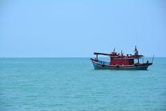 Fisherman Boat. Solo fisherman boat parked near shore of Terengganu, Malaysia Royalty Free Stock Photo