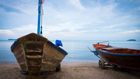 Fisherman boat stopped on the beach after work on sunset. Royalty Free Stock Photography