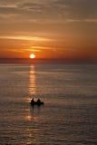Fisherman boat at sunrise Stock Image