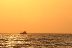 Fisherman boat at sunrise Royalty Free Stock Photo