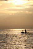 Fisherman in the boat at sunrise Stock Photography