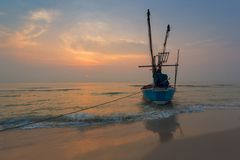 Fisherman Boat with sunrise sky environment Stock Photos