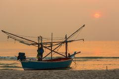 Fisherman Boat with sunrise sky environment Stock Images